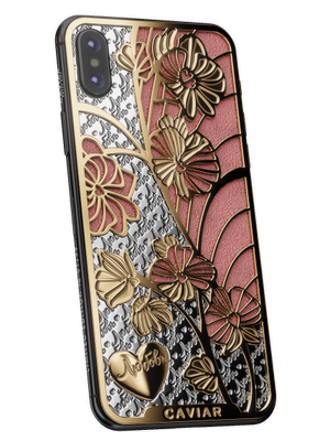 women iPhone X with orchinds cover